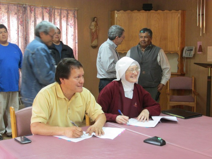 Mother Marietta and Governor Joshua Madalena of the Jemez Pueblo sign the papers selling the former Cor Jesu Monastery to the Jemez Indians.