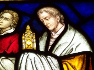 Detail of stained glass windows depicting Corpus Christi that Father Gerald acquired from France.