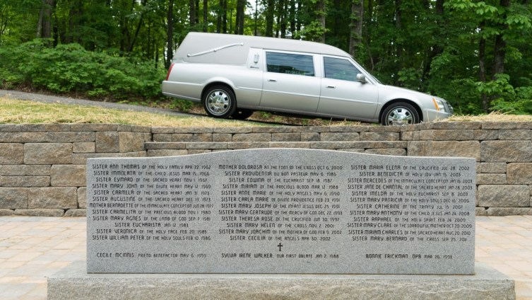 Bridges Funeral Home Hearse bears Sister Mel Pierre to the entrance of Blessed Sacrament Cemetery, only recently completed. The monument bears the names of our dearly departed interred on March 29th, 2016.