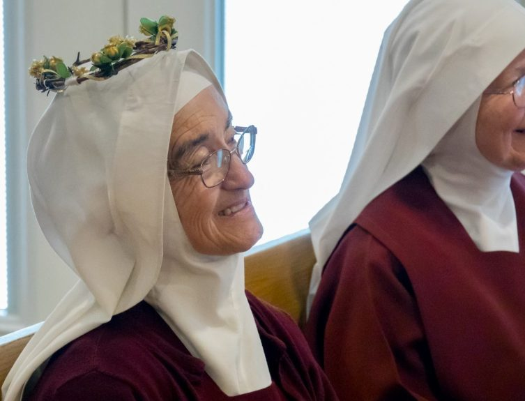 Our Golden Jubilarian returns smiling and radiant to her pew