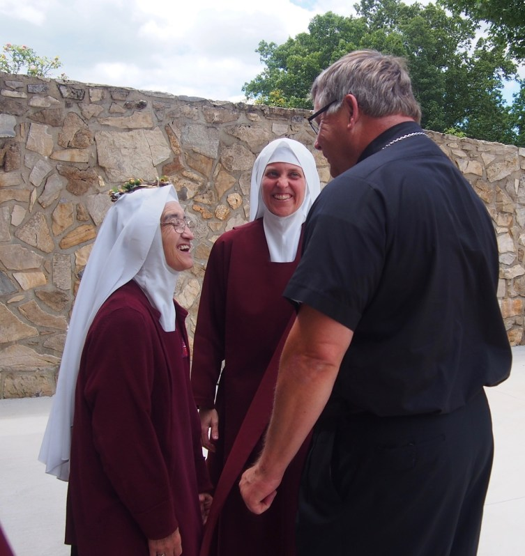 Sister Rose Anne shares a laugh with Bishop Stika just after the Mass.