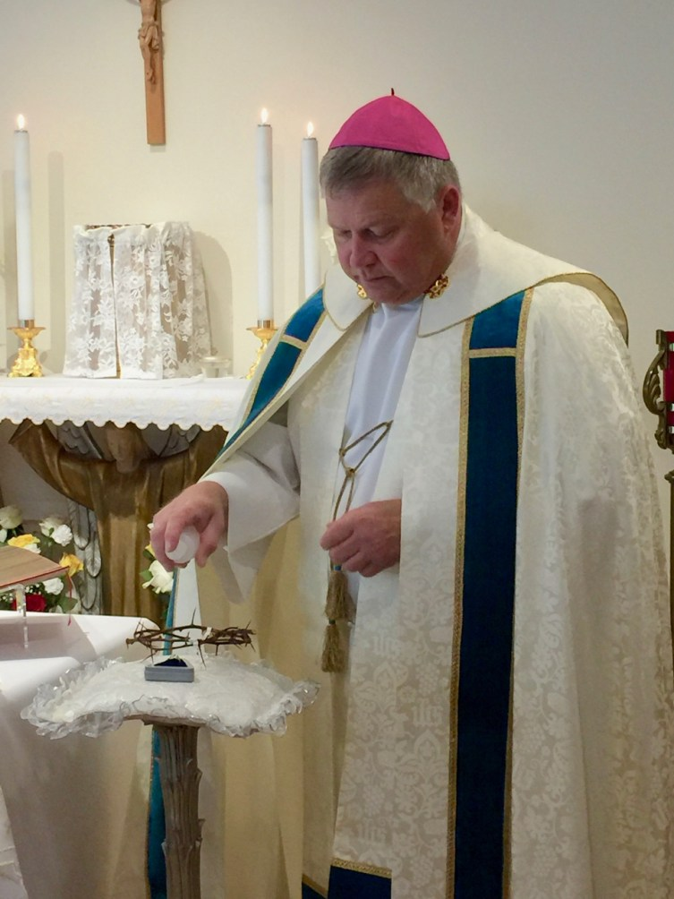Bishop Stika blesses the Crown and Ring