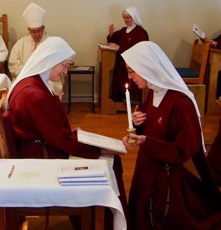 Sister kneels and makes the sign of the cross before making her Final Profession as a Handmaid of the Precious Blood