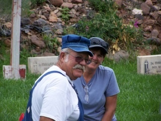 Charlie and Susan Pate, our Dynamic Duo from New Mexico, take a break in Resurrection Cemetery during the transfer of the Sisters.