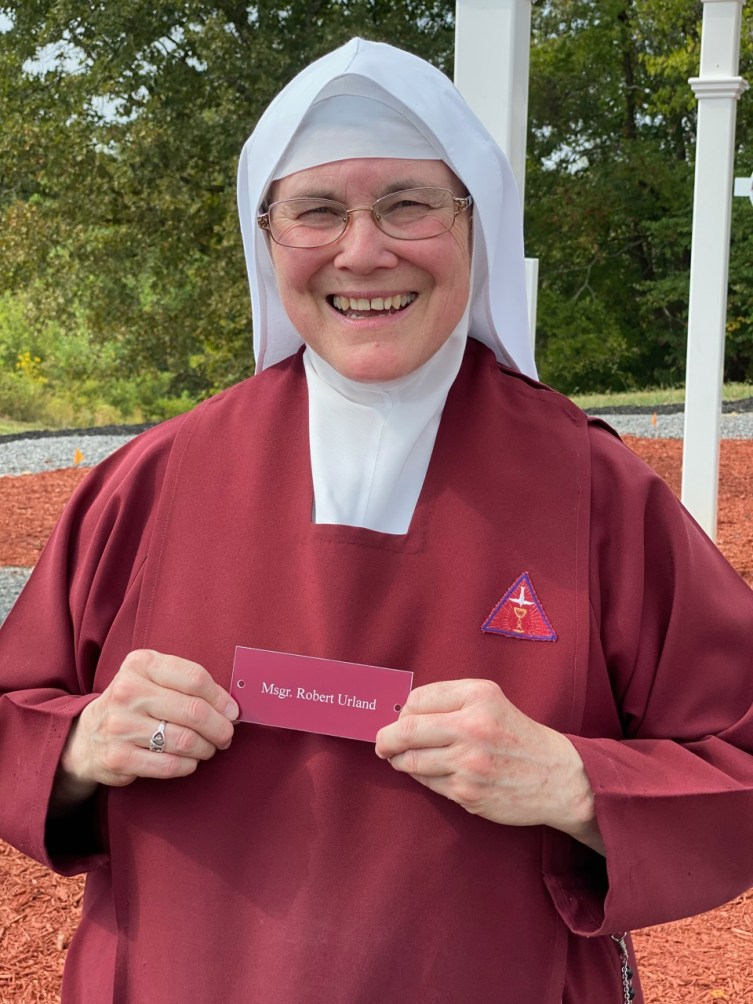 Sister Sarah Michael, now Mother Sarah Michael, holds the plate for Msgr. Robert Urland, who we knew from our time stationed in Italy while he served in the Vatican.