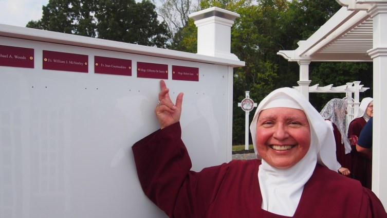 Sister Maristella points to the name of our dear chaplain from our Priory years in Italy, Dom Gilberto.