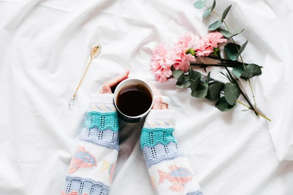 """Why Learning How to Say """"No"""" is a Part of Self Care: Holding a cup of tea."""