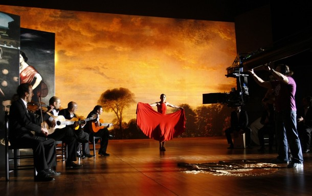 """Flamenco dancer Sara Baras performs next to flamenco singers and guitarists during the filming of """"Flamenco, Flamenco"""" in the Andalusian capital of Seville"""