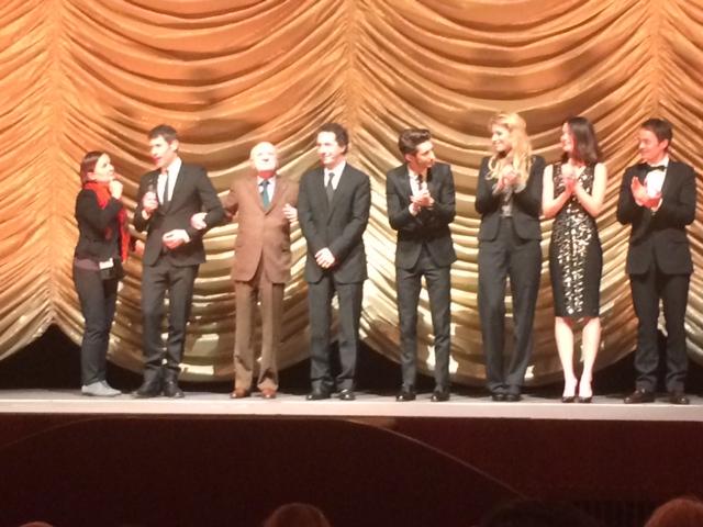 Da sinistra: il regista del film (con l'interprete), PIerre Bergé, Guillaume Gallienne, PIerre Niney e gli altri attori sul palco dello ZooPalast alla fine della poriezione