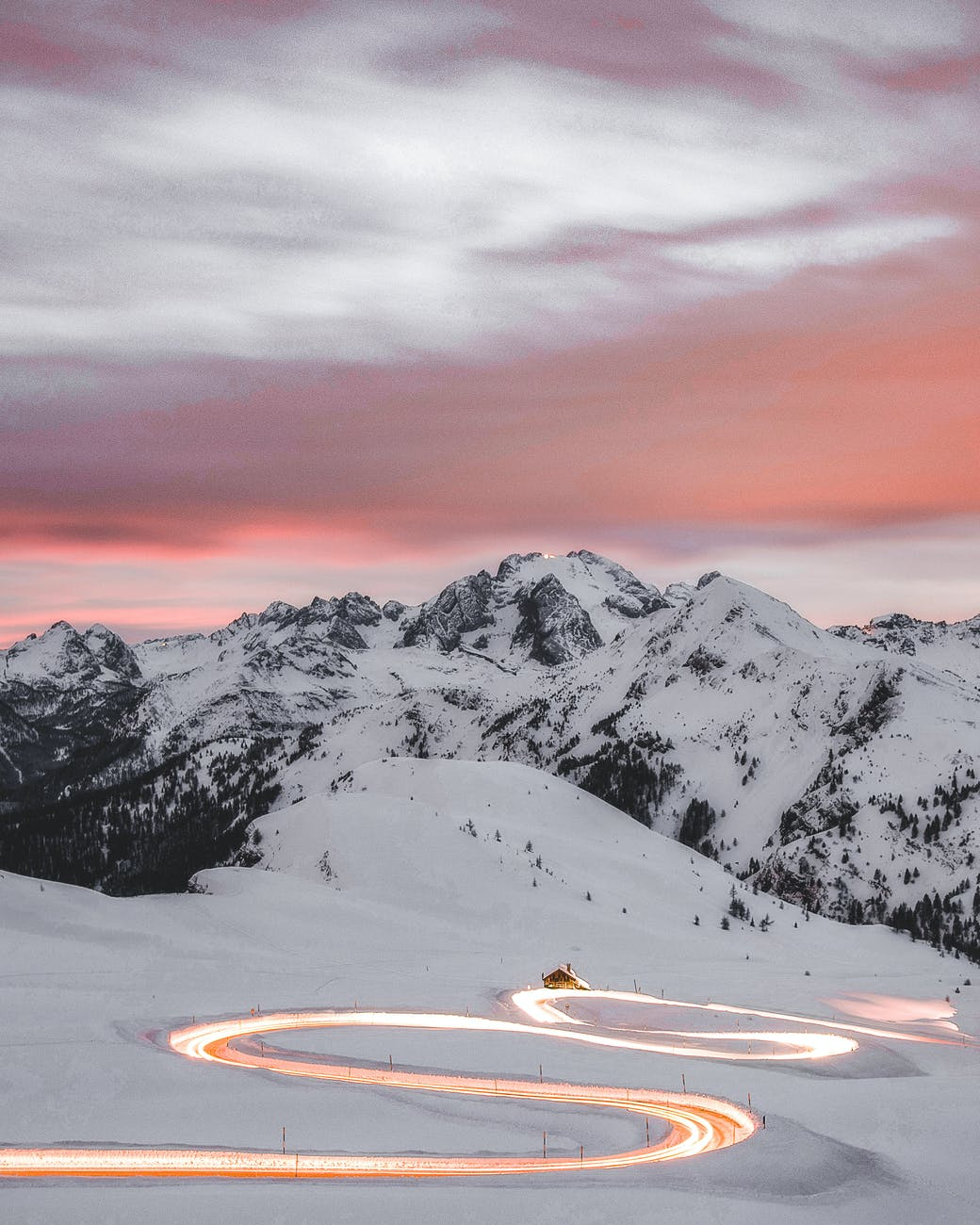 time lapse photography of curved road with vehicles passing