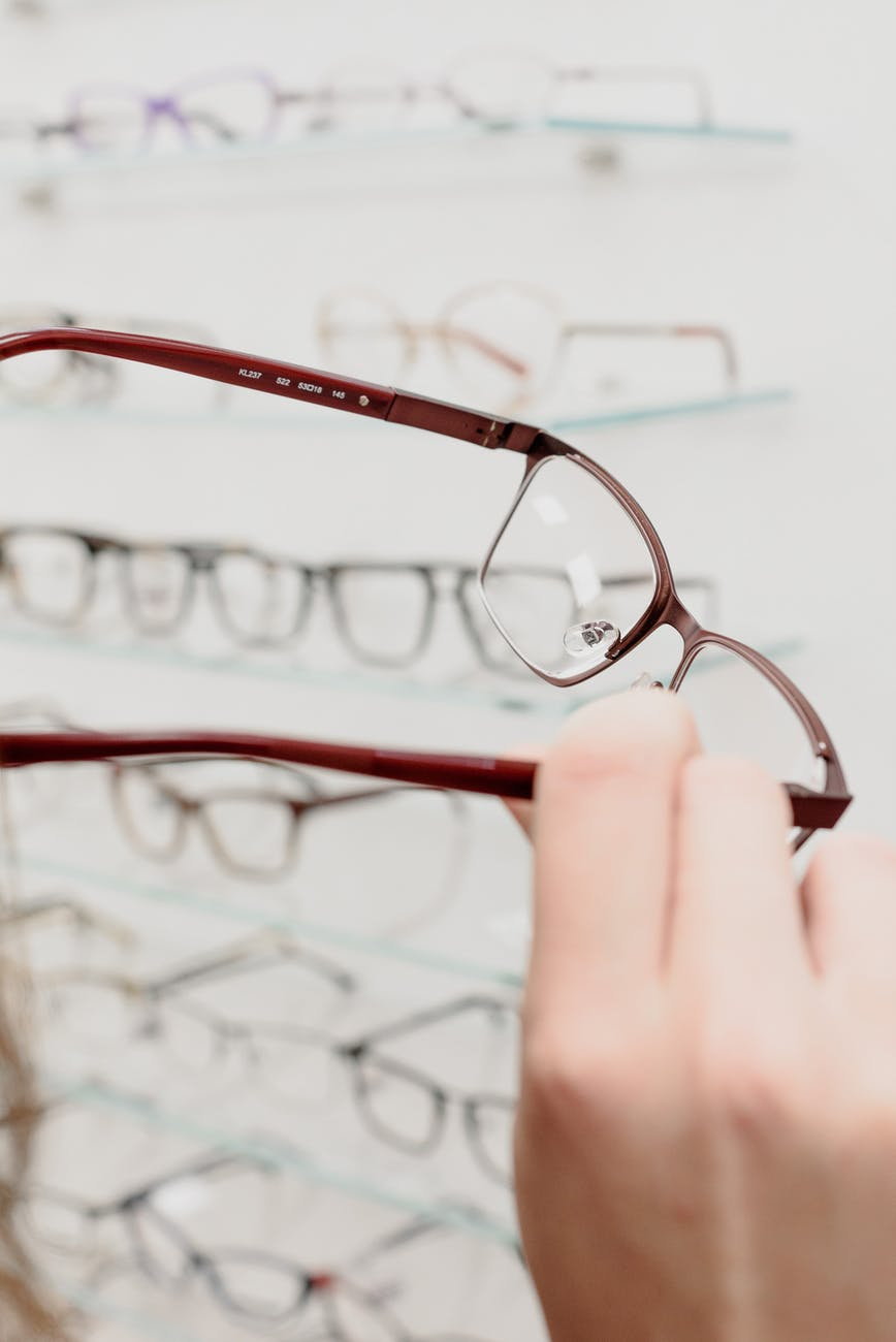 woman with eyeglasses in optical shop