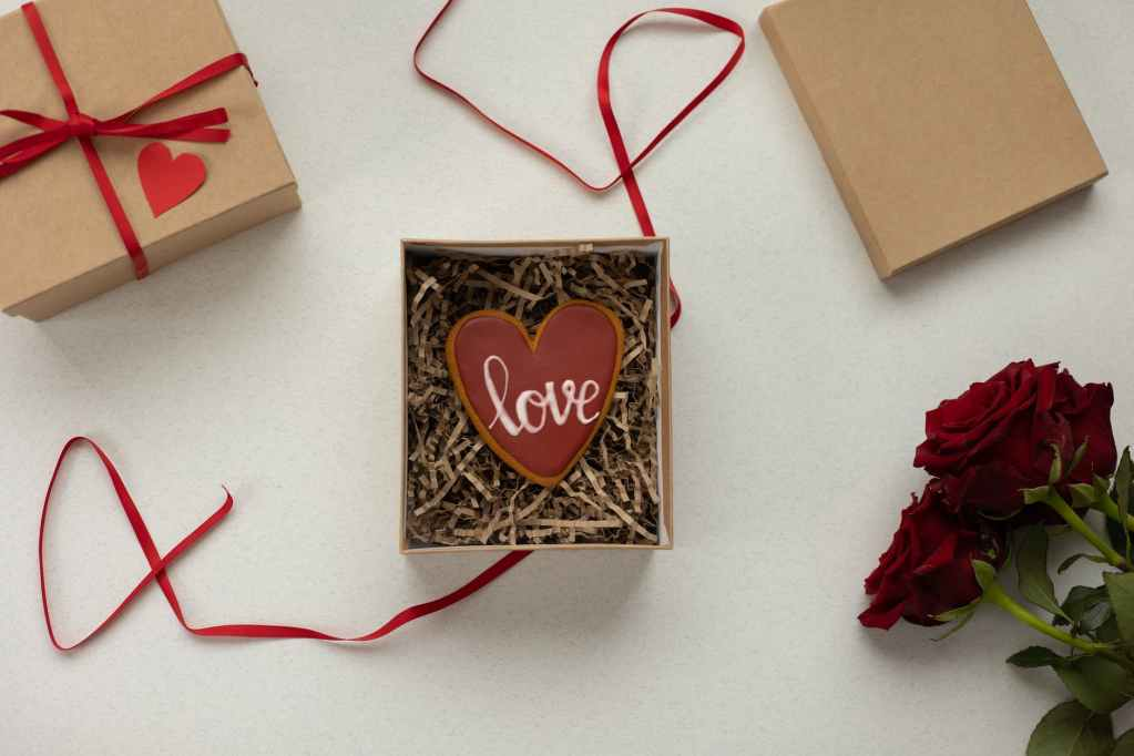 gift boxes with heart shaped cookie and flowers