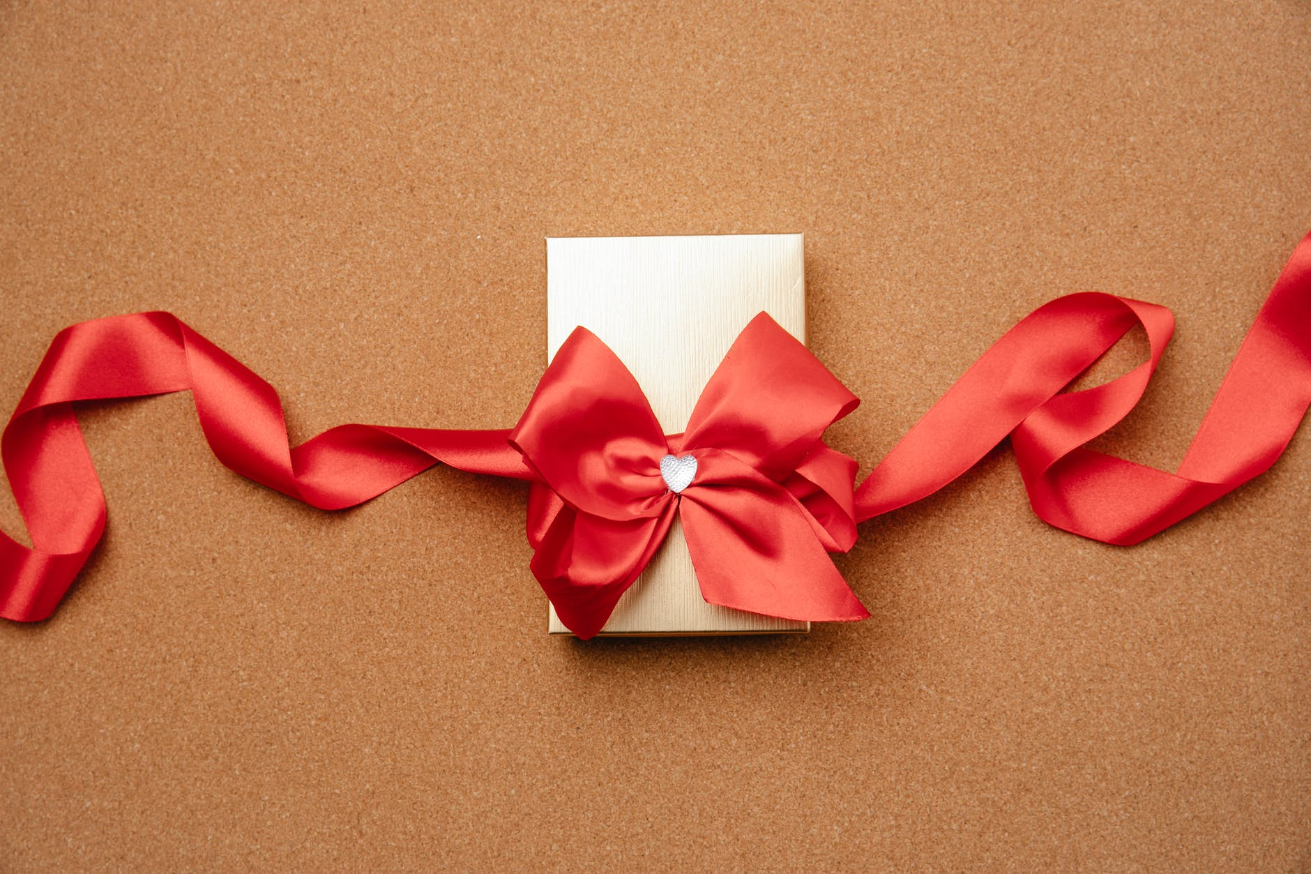gift box decorated with red ribbon