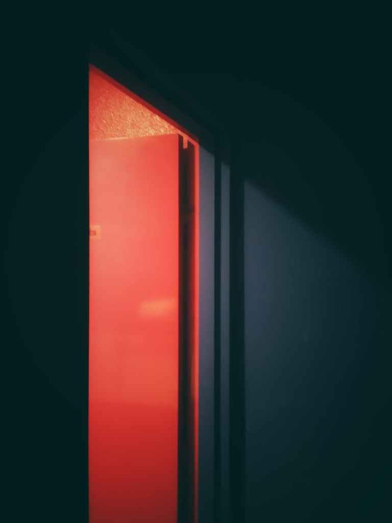 an open red flush door