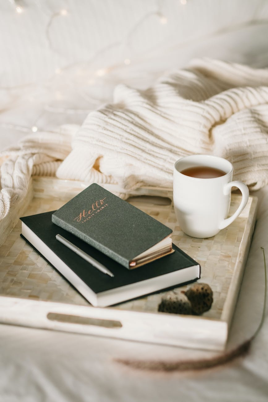 photo of cup beside books
