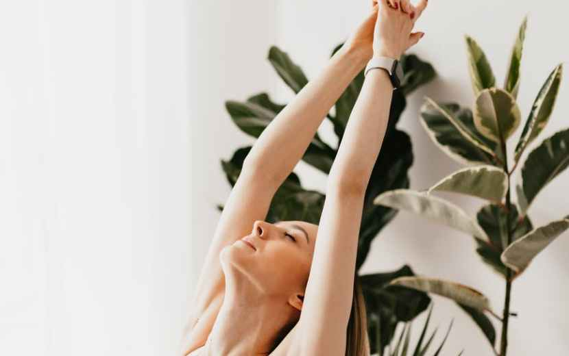 flexible sportswoman doing yoga exercise at home