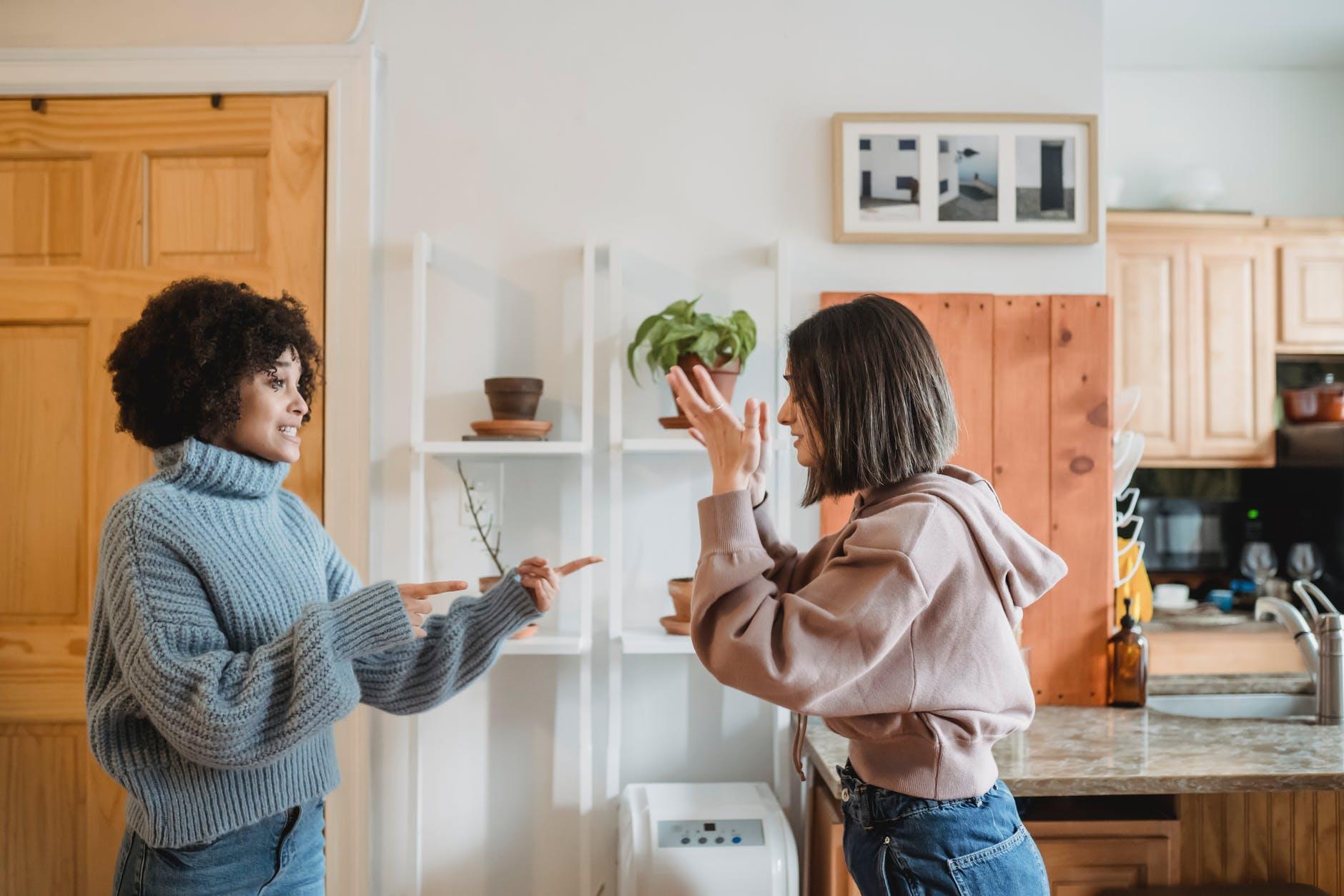 irritated multiracial women fighting in apartment