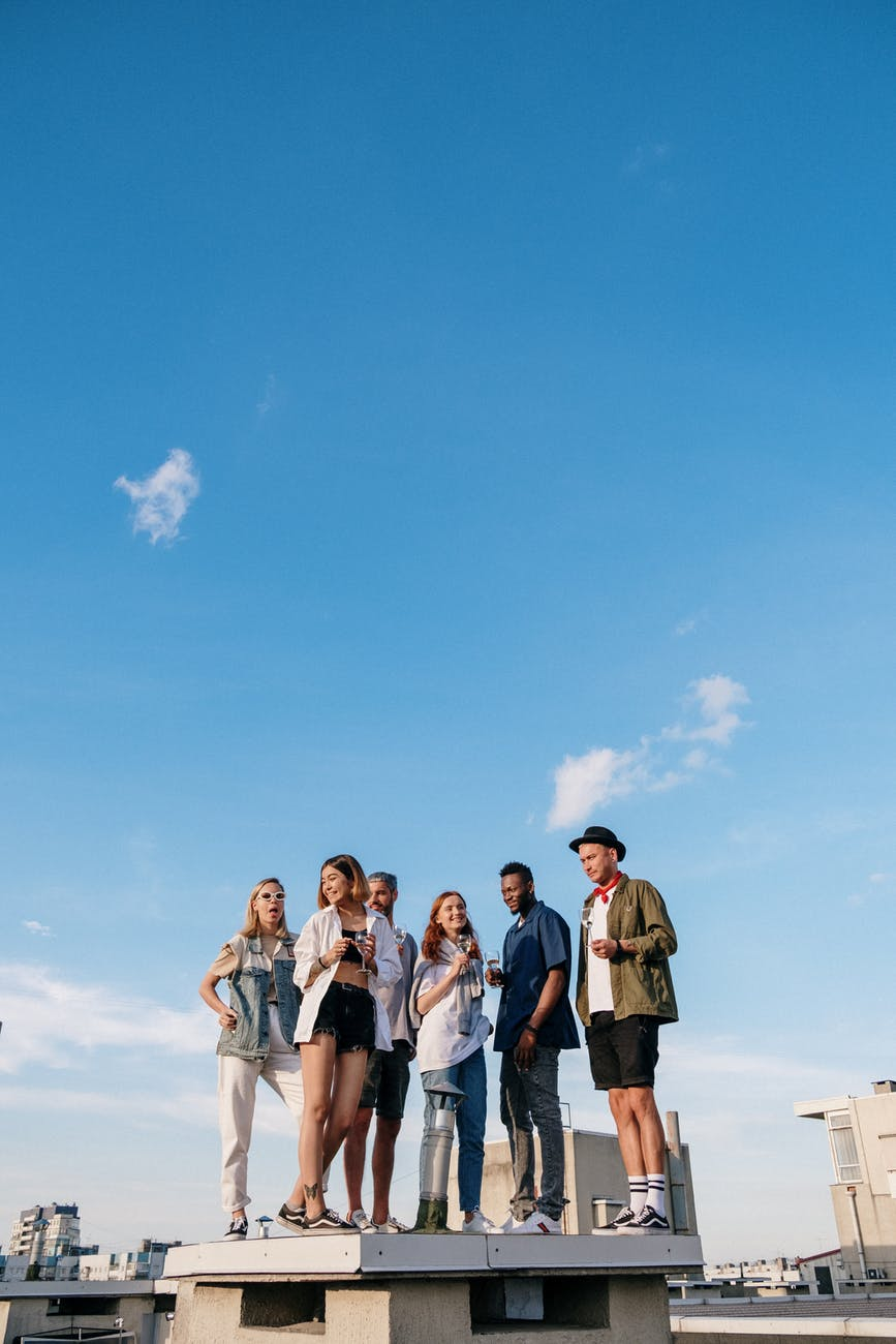 group of people standing on beach