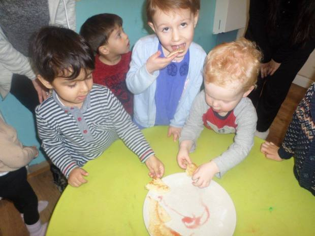 Children making pancakes at Nursery