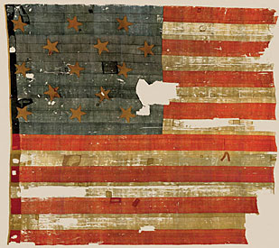 Who made this famous 1813 American flag, currently on exhibit at the Smithsonian?