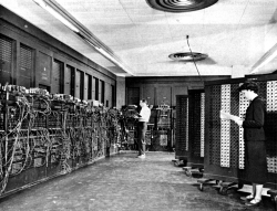 """""""The ENIAC, in BRL building 328. Left: Glen Beck, Right: Frances Elizabeth Snyder Holberton"""" (Source: US Army Photo Public domain, from K. Kempf, """"Historical Monograph: Electronic Computers Within the Ordnance Corps,"""" via Historic Computers Images of the ARL Technical Library.)"""