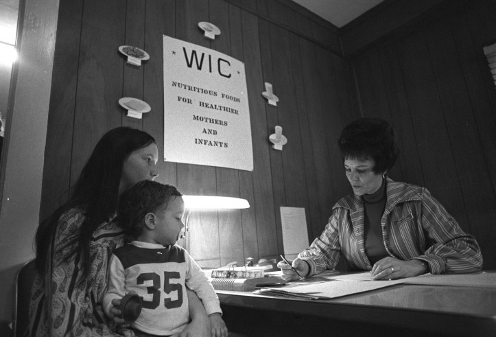 A mother signing up for WIC food supplements in Kentucky, January 1974. Photo courtesy of the National Archives and Records Administration. (USDA/Flickr CC BY 2.0)