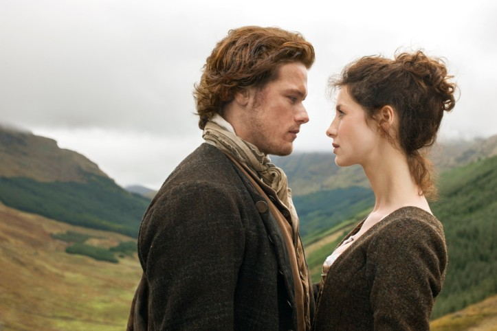 Outlander characters Claire Randall and Jamie Fraser facing each other