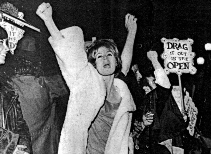 """""""Drag it out in the open"""" protest photo from Victor Silverman's and Susan Stryker's 2005 documentary Screaming Queens: The Riot at Compton's Cafeteria."""