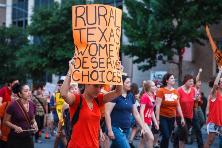 "Protest rally against HB2/SB1, with poster text: ""Rural Texas women deserve choices."""