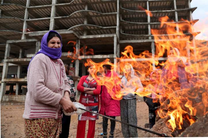 Yazidi women, displaced by ISIS militants, at a shelter in Dohuk, Iraq. (Seivan Selim/AP)
