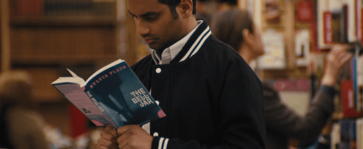 Master of None screenshot of Dev Shah reading Sylvia Plath's The Bell Jar. (fashion-and-film/Tumblr)