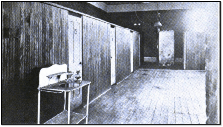 Row of windowless rooms rented out by the night in Denver. (Denver Tuberculosis Association)