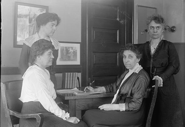 Julia Lathrop, first Bureau Chief of the US Children's Bureau, and staff. (Harris & Ewing/Library of Congress)