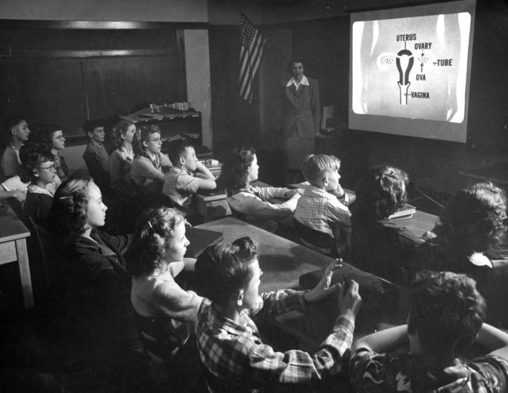 """A 7th-grade class in Eugene, Oregon watching one of the first showings of the sex education film Human Growth, in 1948. (""""Sex Education: Oregon Film Provides New Approach to Delicate Problem,"""" LIFE, May 24, 1948, 55.)"""