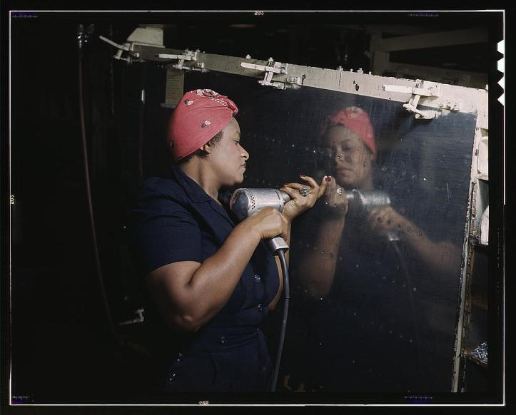 A woman operating a hand drill in a Tennessee factory, working on a WWII dive bomber, in February 1943. (Alfred T. Palmer/US Library of Congress)