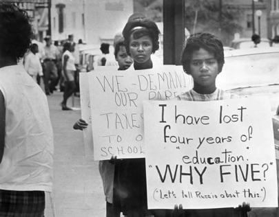 """Refusing to integrate schools, the Prince Edward County, VA, Board of Supervisors instead refused to fund them, closing the school system from 1959 to 1964. This photo shows students protesting this """"massive resistance"""" to the Brown decision. (Richmond Times-Dispatch)"""