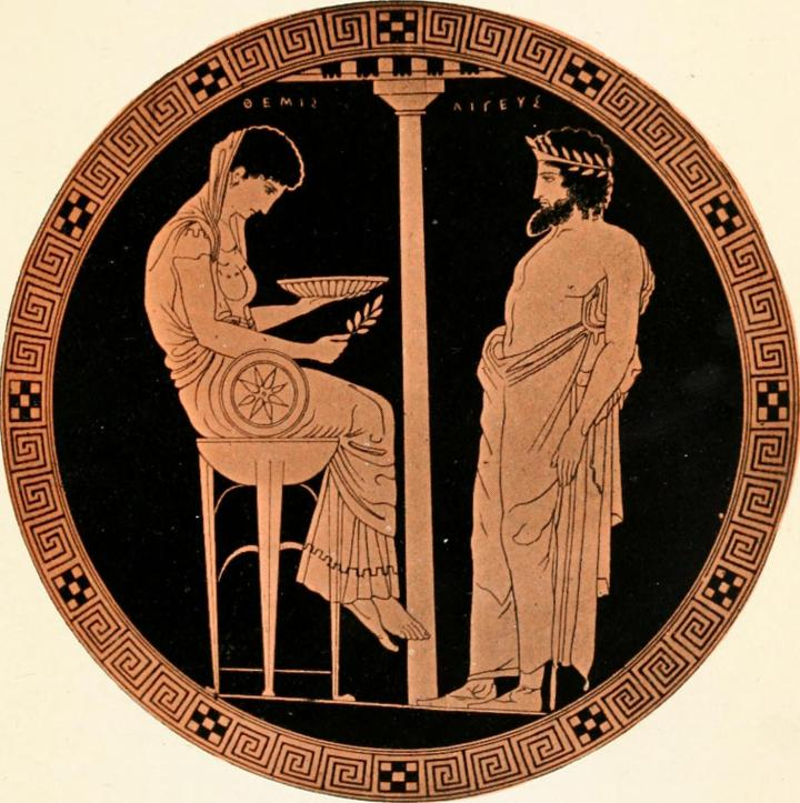 Greek engraving of a woman sitting on a high stool, holding a bowl and a feather, and facing a man leaning with his hips thrust at her.