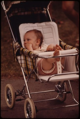 White baby in a stroller ca. 1970.