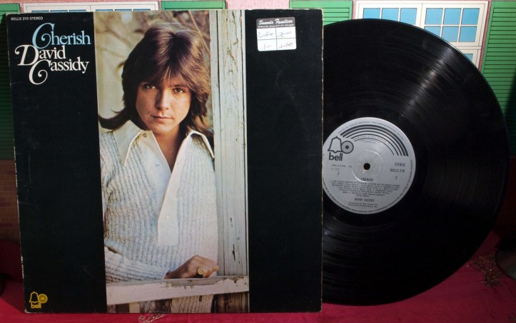 Photo of the album cover of David Cassidy's Cherish album, with the record itself peeking out of the sleeve