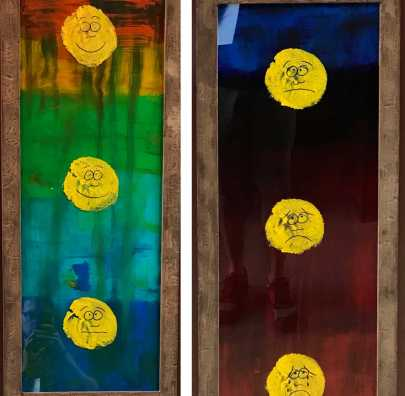 Photo of a painting showing a series of round yellow faces making different expressions from happy to content to sad and in pain