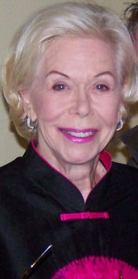 Headshot of an older white woman with blonde hair, pink lipstick, and a wrinkly neck.