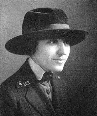 Black and white portrait of Otilia Noeckel, in a wide-brimmed hat and a military uniform.