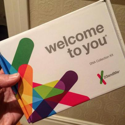 A 23andme box with bright shapes in saturated colors on a white background reading: Welcome to you, DNA collection kit, 23andme.