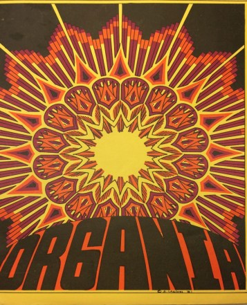 The cover of the Organia fanzine. This issue featured a bright yellow cover with an intricate burnt oragne and dark red sunburst illustration and the title of the fanzine in large black lettering (Organia).