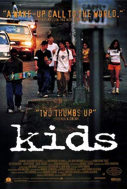 A group of teens in 1990s-era clothing (baggy pants, hats turned backwards, big baggy tshirts, holding skateboard and wearing backpacks) walk down a city street and sidewalk, with the word KIDS in typed lettering at the forefront.