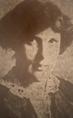 Newsprint photo of Juliet Poyntz, a white woman in a lace collared dress with a dark hair pinned up. .