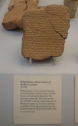 Cuneiform tablet fragment sitting on a display case