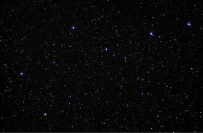 Photo of the night sky, featuring the Big Dipper.