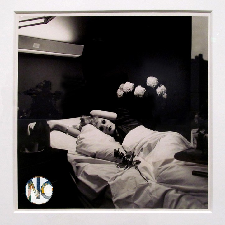 Candy Darling lies on her side in a hospital bed, with heavy eye makeup, one arm tossed over her head.