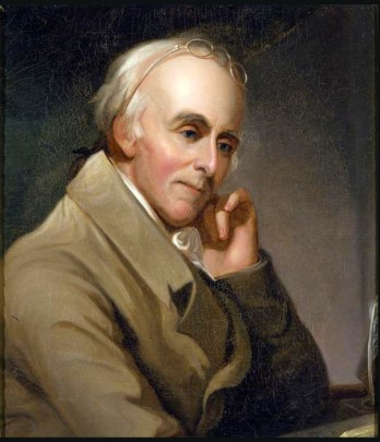 Painting of Benjamin Rush, who poses facing to the right of the frame, his head rested lightly on his left fist, wearing a tan 18th century dinner jacket